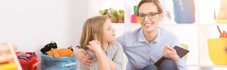 School girl on compensatory lesson with her young teacher Stock Photo