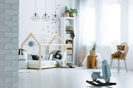Toys in white baby room with white and black decoration Stock Photo