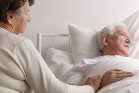 Senior loving couples hearthbreaking touching last moments in hospice