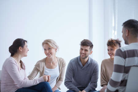 Group of young people helping each other during psychotherapy Stock Photo