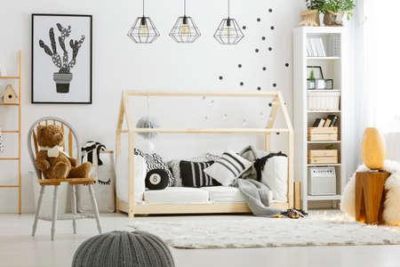 cosily: Black decoration in cozy white room designed in scandi style