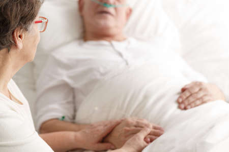 Loving wife caring about dying ill spouse before his death Stok Fotoğraf - 78851648