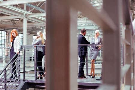 break from work: Businessmen  and businesswomen during work break in company