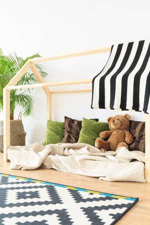 Soft eco friendly textiles in minimalist baby room Stock Photo