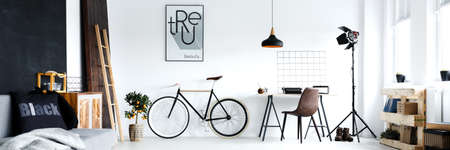 Panorama of minimalistic man's room with hipster work area