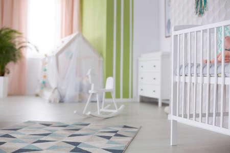 Cozy white modern room prepared for newborn baby