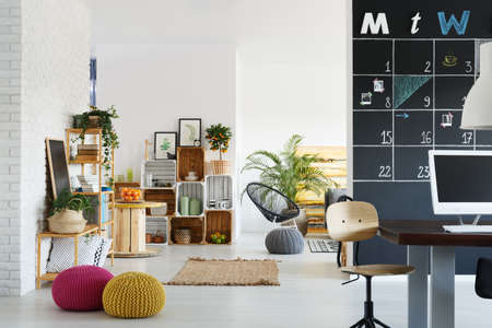 Modern office with bright relax zone with pallet furniture Stock Photo