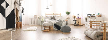 yourself: Messy wooden bed in the large bright bedroom