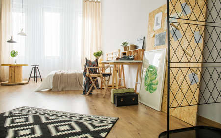 yourself: Spacious bedroom decorated with wooden accessories and posters