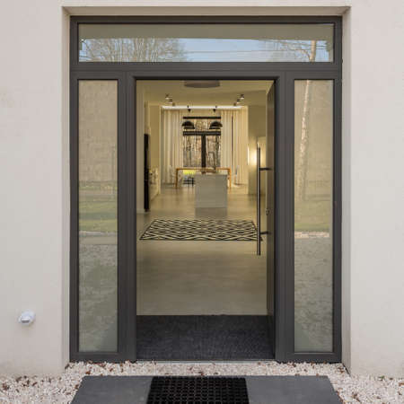 Simple and modern glass door entrance to elegant house
