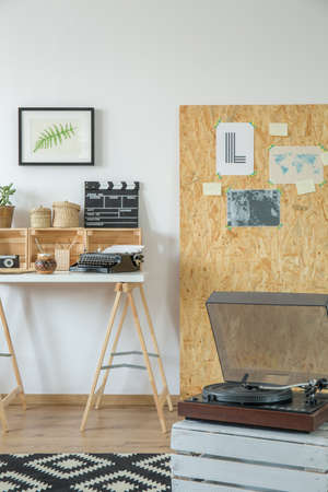Old record player in cozy modern room