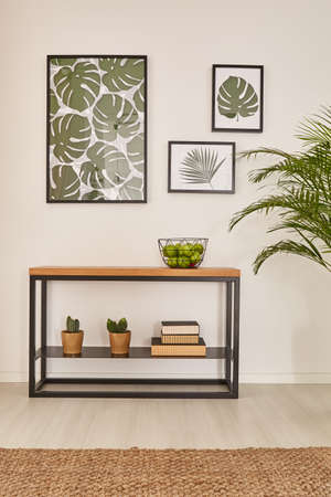 Minimalist desk with succulents and monstera pictures Stock Photo