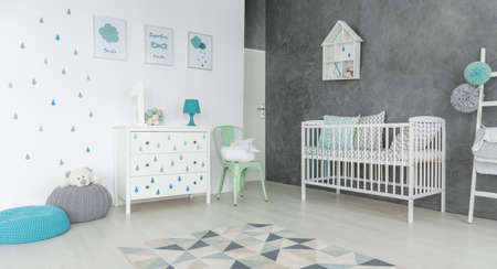Cosy childs room with a blue pouf
