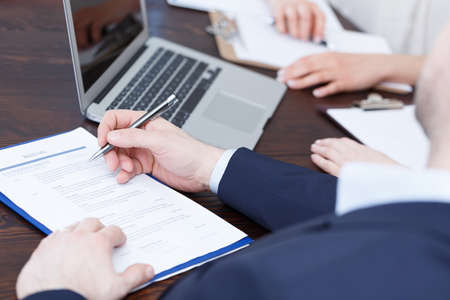Members of cadre checking a resume after recruitment review Stock Photo