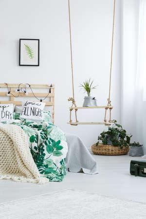 open floor plan: Bedroom with DIY swing shelf and double bed