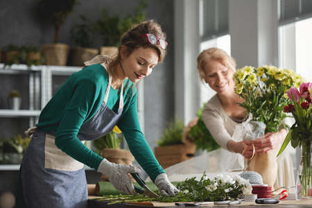 yourself: Young woman working in modern flower shop