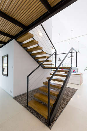 entresol: Modern wooden staircase in white minimalist interior with high ceiling