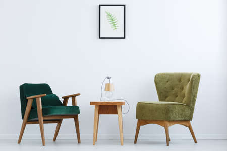 ascetic: Ascetic, white home interior with green chairs, table and lamp Stock Photo