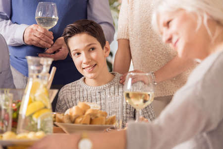 Young boy smiling and looking at his grandma