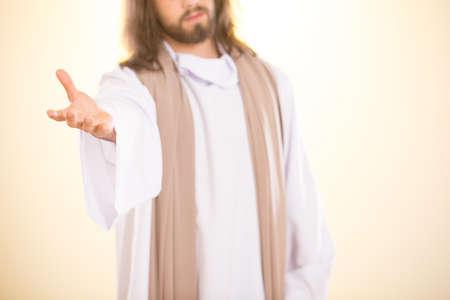 Foto van Jezus Christus, die zijn hand uitsteek