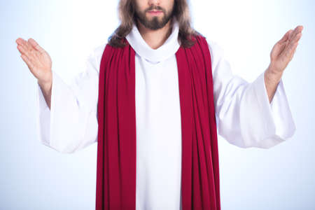 Jesus Christ standing calmly with open arms