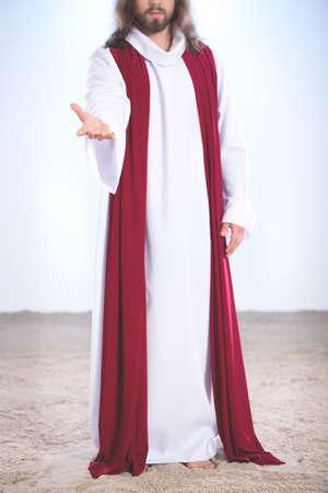 Jesus Christ after resurrection standing on sand Stock Photo