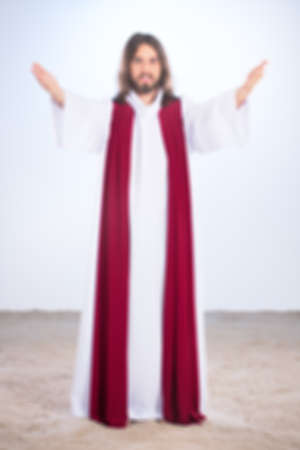 Blurry photo of Jesus Christ with open arms smiling
