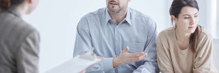 Marital conflict and mediator during professional relationship therapy Stock Photo
