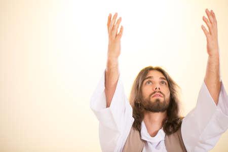 Jesus Christ raising his hands up to heaven