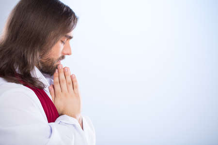 Jesus Christ praying with closed eyes and folded hands Reklamní fotografie