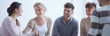 People smiling being happy about successful group therapy for addicted Stock Photo