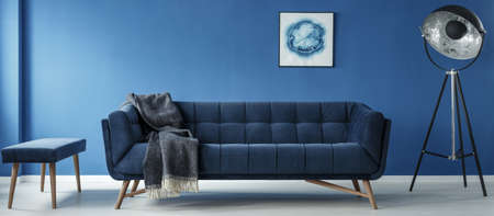 Sofa and lamp in modern minimalistic blue room