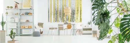 chandelier background: Spacious and bright room with dining area Stock Photo