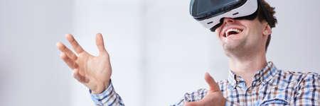 Young, handsome man inside virtual reality Фото со стока