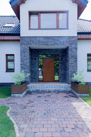 Elegant and modern main entrance to the detached house