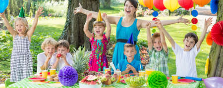 childs birthday party: Children enjoying together the garden party Stock Photo
