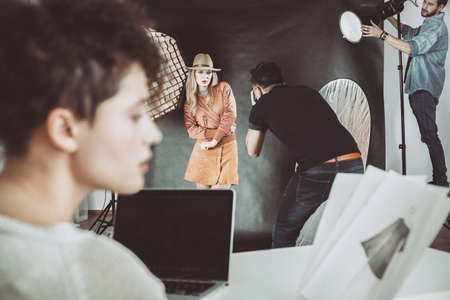 Backstage at photoshoot with model and photographer