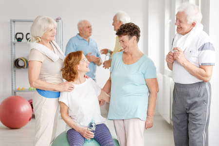 Senior active people spending time together in a gym Stock Photo