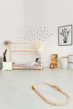 Scandinavian style inspiration of cream-colored delicate baby bedroom