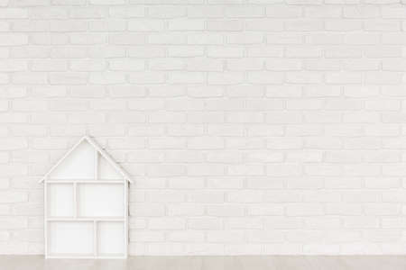 White brick wall in baby room with white dollhouse