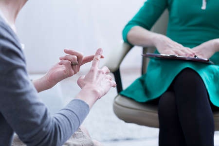 Close-up of womans hands explaining the problems to psychotherapist