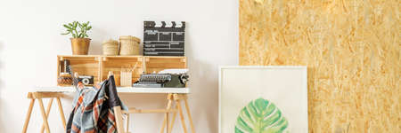 Simple home office with desk, chair, and osb wall, panorama Stock Photo
