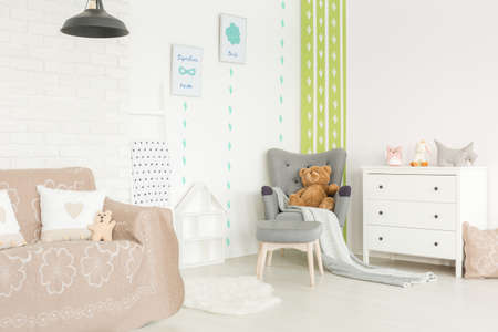Bright and cozy interior of baby room with pastel accessories