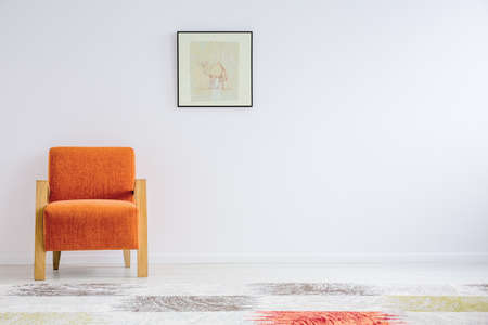 Orange armchair in style with copy space Stock Photo