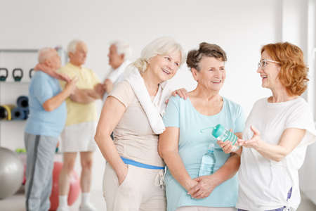 Group of aged women having fun together in a gym