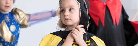 Sad little girl dressed up in a bee costume