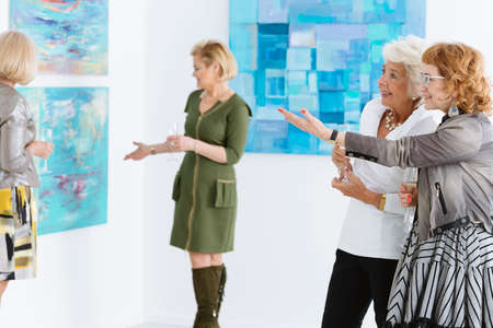 curator: Two female friends admiring the painting in art gallery