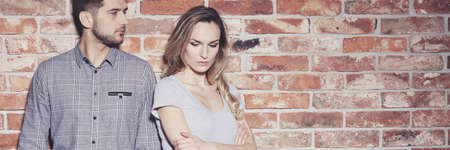 Passionate stylish young couple standing against brick wall Stock fotó - 81377401