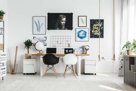 Creative home office with double desk and two chairs