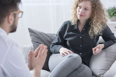Young attractive woman smiling during therapy session